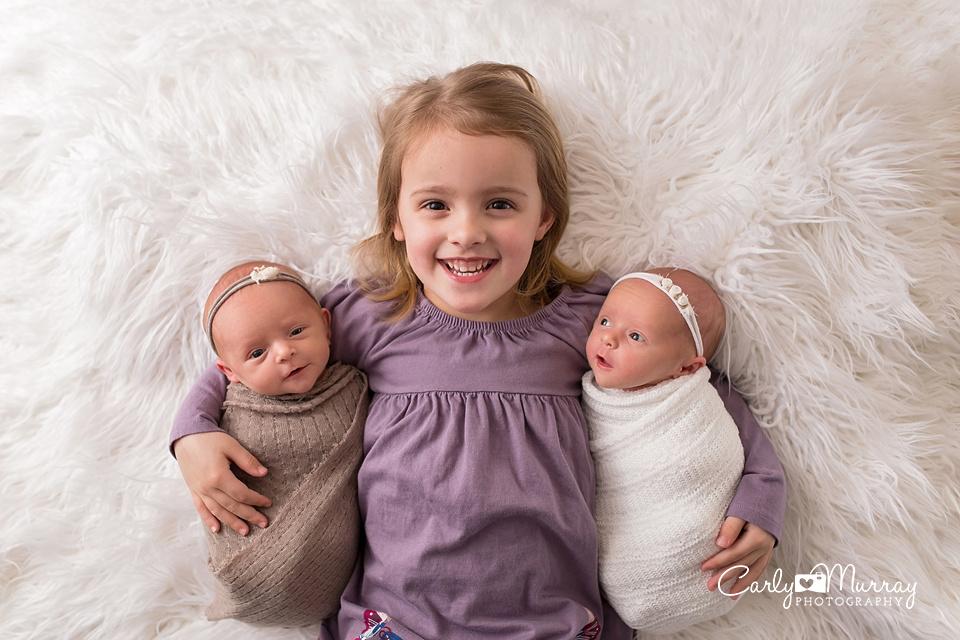 These sweet girls were here last week for their newborn session it is always fun to photograph newborn twins and their big sister did such a great job with